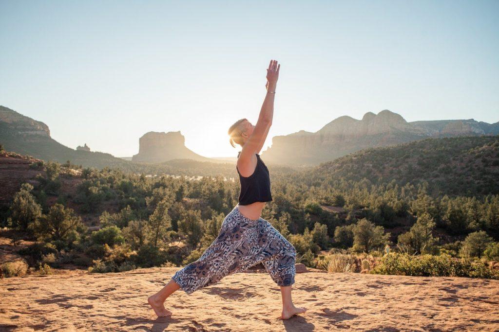 young woman doing yoga in yoga pants